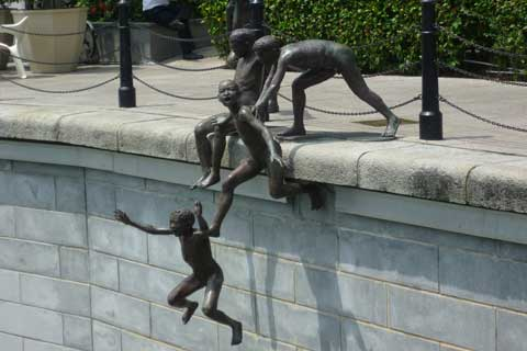 Antique Bronze Naughty Boys Sculpture Beside River