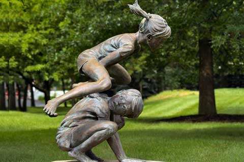 Antique Bronze Two Kids Playing on Lawn Statue for Sale